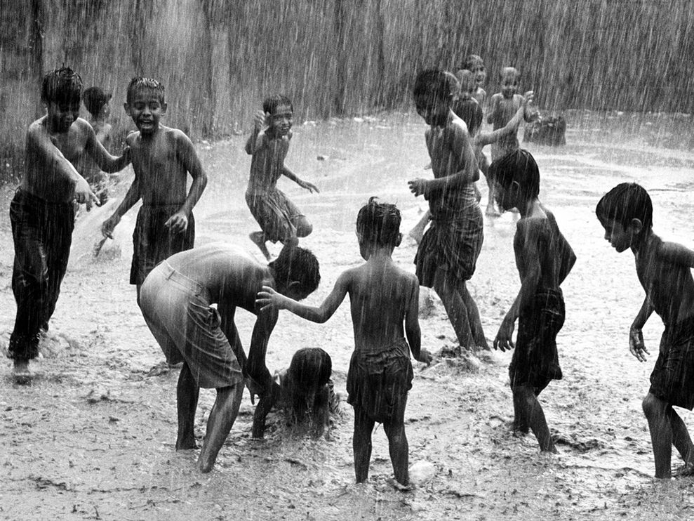 children-play-rain-india